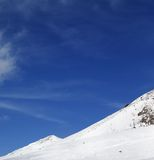 Winter snowy mountains and ski slope Royalty Free Stock Image