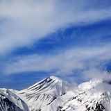 Winter snowy mountains and sky with clouds at nice day Royalty Free Stock Image