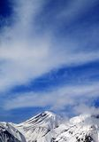 Winter snowy mountains and sky with clouds at nice day Royalty Free Stock Photos