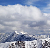 Winter snowy mountains and sky with clouds at nice day Stock Photography