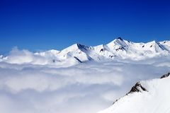 Winter snowy mountains under clouds at nice day Royalty Free Stock Photography