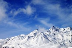 Winter snowy mountains at windy day Royalty Free Stock Images