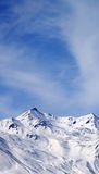 Winter snowy mountains at windy day Stock Images