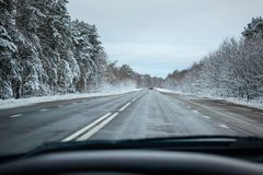 Winter snowy road from the car window. Stock Images