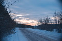 Winter snowy road landscape evening out of town. Stock Photos