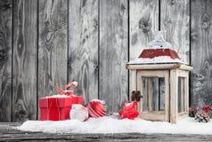 Winter snowy scenery with lantern Stock Image