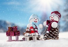 Winter snowy scenery with snow men Stock Image