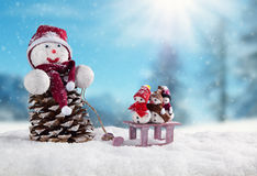 Winter snowy scenery with snow men Royalty Free Stock Image