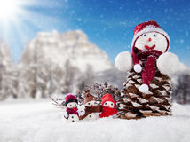 Winter snowy scenery with snow men Royalty Free Stock Images