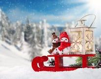 Winter snowy scenery with snow men Royalty Free Stock Photos