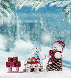 Winter snowy scenery with snow men Royalty Free Stock Photos