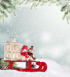 Winter snowy scenery with snow men Stock Images