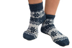 Winter socks on his feet. On a white background Stock Images