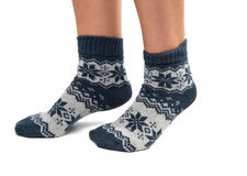 Winter socks on his feet. On a white background Stock Photography