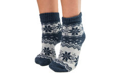 Winter socks on his feet. On a white background Stock Photo