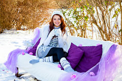 Winter, sofa and woman with cup in hand Royalty Free Stock Photography