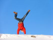 Winter Somersault. Somersault on the snow under the blue sky Royalty Free Stock Photography