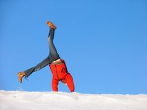 Winter Somersault. Somersault on the snow under the blue sky Royalty Free Stock Photo