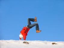 Winter Somersault. Somersault on the snow under the blue sky Stock Photo