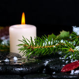 Winter spa concept of evergreen branches with drops, snow,  cand Stock Photos