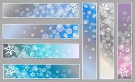 Winter sparkling banners with snowflakes. Set of winter sparkling  banners with snowflakes for new year and Christmas on the blue, grey and purple background Royalty Free Stock Photos