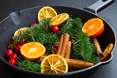 Winter spices with cinnamon, orange, cranberry, anise, fir tree Stock Photo