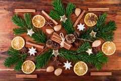 Winter spices composition on dark wooden background. Christmas spices rustic still life Stock Photography