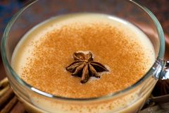 Winter spicy masala tea in a glass cup, closeup royalty free stock images