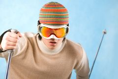 Winter sport. Portrait of healthy sportsman in goggles skiing on resort Stock Photography