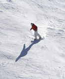 Winter sport. Skiboarder down hill stock images