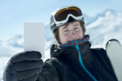 Winter sport atlethe showing lift pass Royalty Free Stock Images