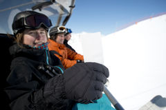 Winter sport girl in chair lift with ticket Stock Photo