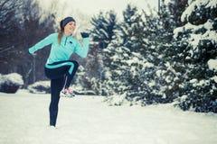 Winter sport, girl exercising in park Stock Photo