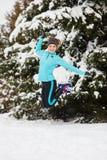 Winter sport, girl jumping in snow Stock Photos