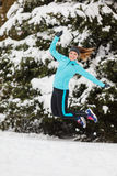 Winter sport, girl jumping in snow Royalty Free Stock Image