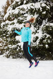 Winter sport, girl jumping in snow Royalty Free Stock Images