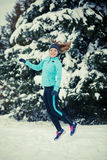 Winter sport, girl jumping in snow Stock Photography
