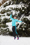 Winter sport, girl jumping in snow Royalty Free Stock Photos