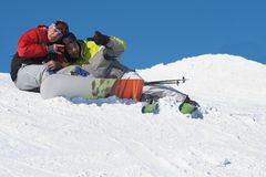 Winter sport lifestyle concept. Snowboard and ski friends on snow. Winter sport lifestyle concept stock image