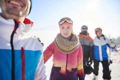 Friends with snowboards and skis Stock Image