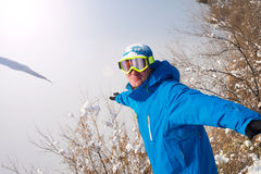 Winter sport. A man snowboarder in the goggles having fun playin Stock Images