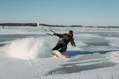 Winter sport: ski and kite Stock Image