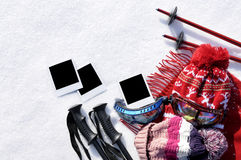 Winter sport ski vacation background with skiing equipment and several blank polaroid style photo prints, copy space Stock Photos
