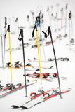 Skis parking, snowy winter scene, next to a ski slope. Winter sport symbol, skis and sticks without skiers, snowy ground Royalty Free Stock Photo