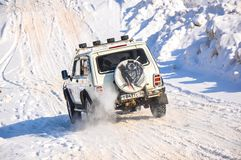 Winter sports car enthusiasts Stock Photography
