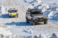 Winter sports car enthusiasts Stock Photos