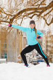 Winter sports, girl exercising in city Royalty Free Stock Photos