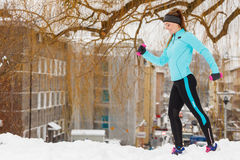 Winter sports, girl exercising in city Royalty Free Stock Photography