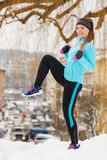 Winter sports, girl exercising in city Royalty Free Stock Photo