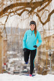 Winter sports, girl exercising in city Stock Photo